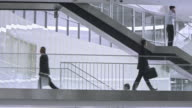 PAN Business people walking on the stairs in corporate building video