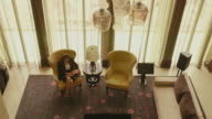 Business people working, hotel room, husband, wife, luxury home video