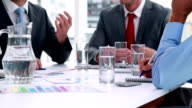 Business people working together at meeting in cinemagraph video