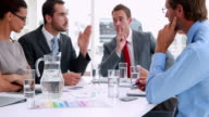 Business people working together at meeting video