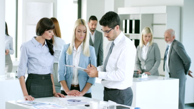 Business people working together video