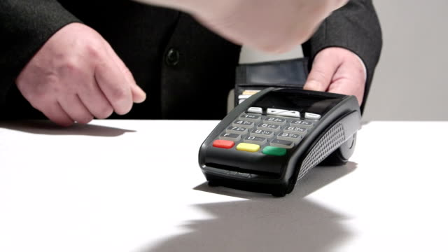 Business person paying using credit card video