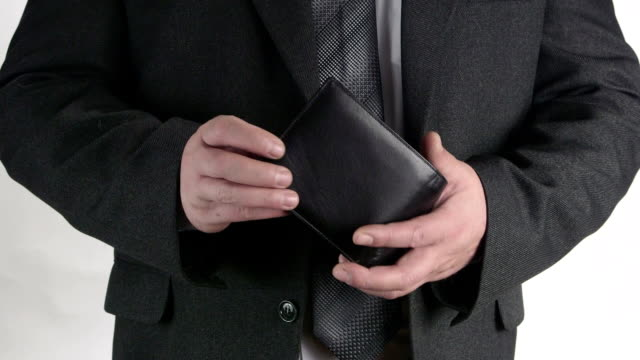 Business person pulling out his wallet from pocket video
