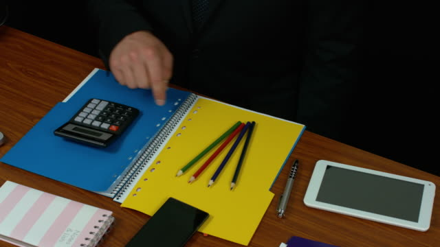 A Business Person Using A Tablet And A Calculator In An Office. video