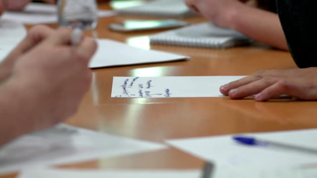 Business Planning. Discussion young people in the new company. You only see the hands. video