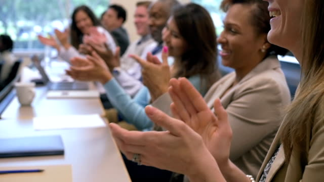 Business professionals applauding speaker at conference or seminar video