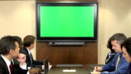 Business Professionals in Front of Chroma Key Monitor video