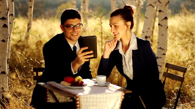 Business Proposal using Tablet Teamwork Outdoors video