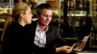 Business Pros in Coffee Shop Discuss Sales Data video