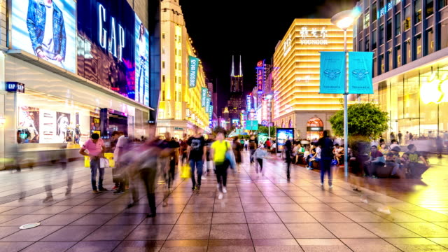business street with crowded people at night in shanghai. timelapse video