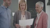 Business Team Brainstorming In Their Office. video