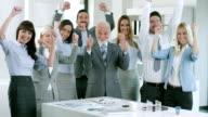 Business team celebrate video
