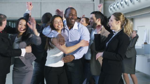 Business team celebrating together video