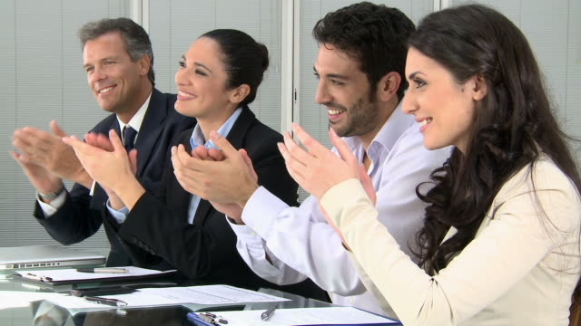 Business team clapping hands video