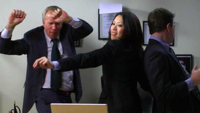 Business team dance in a rain of papers video