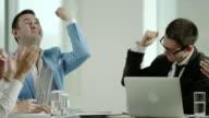 business team enjoying success video