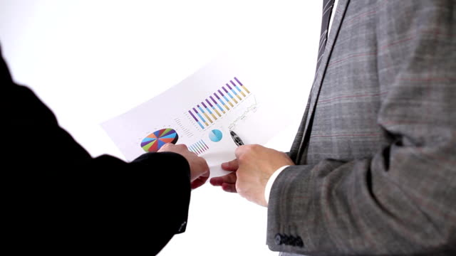 Business team examining graph video