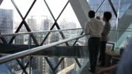 Business team overlooking skyscrapers video