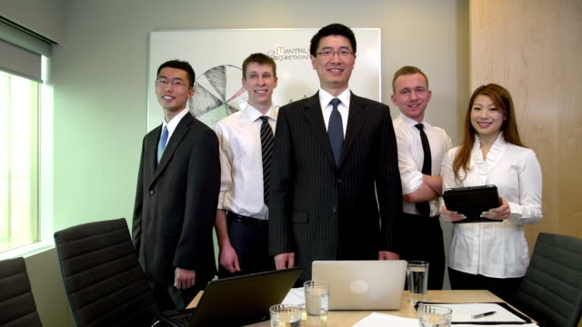 Business team portrait in boardroom video