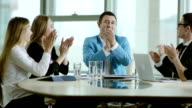 business team rejoice success and applaud video