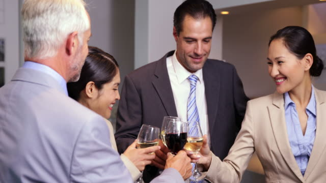 Business team relaxing after work and drinking wine video