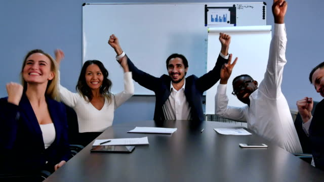 Business team success achievement, people raising arms and smiling video