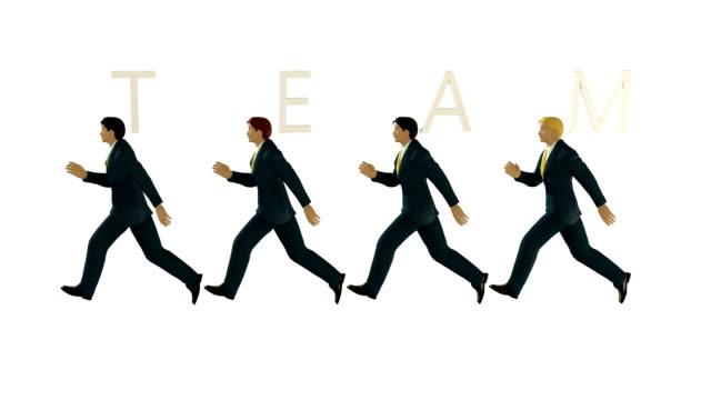 Business TEAM walking against white, seamless loop video