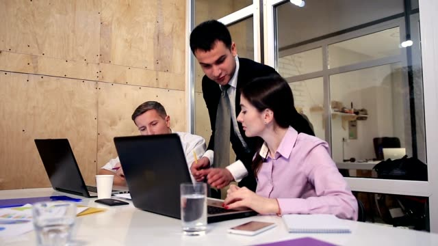 Business team working together at the office video