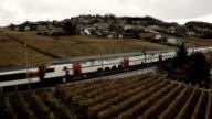 Business Train passing vineyard field in Switzerland video