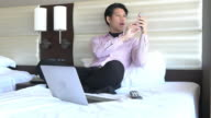 Business travel business man working in hotel room video