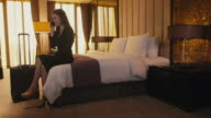 Business travel, hotel room, woman, businesswoman, manager, phone, telephone video