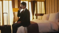 Business travel, people working in hotel room, man, businessman, phone video