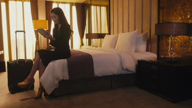 Business travel, people working in hotel room, woman, businesswoman, manager video