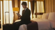 Business travel, people working in hotel room, woman, manager, ipad video