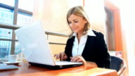 Business woma typing on laptop. video