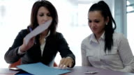 Business woman at office sitting at table and signing new contract video