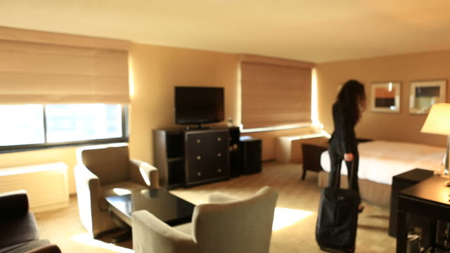 Business Woman entering hotel room video