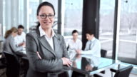 SLO MO Business woman in conference room portrait video