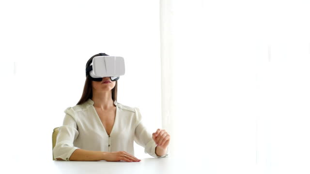 Business woman in glasses working with vr virtual reality video
