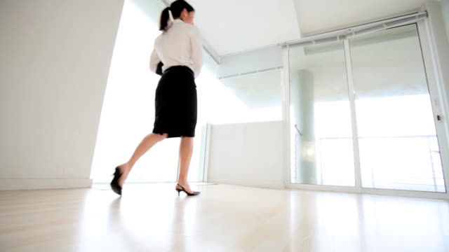 Business Woman inspects empty apartment office video