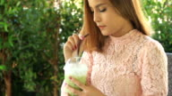 business woman is working and drinking coffee at outdoor coffee cafe video