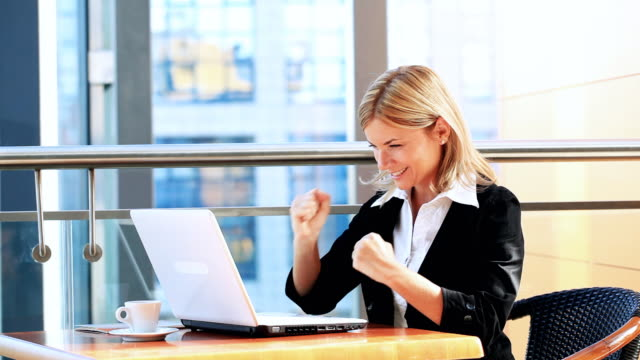 Business woman looking at statistics on Istockphoto. She enjoys life! video