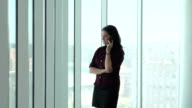 Business woman on the phone in office building, slow motion video