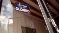 Business woman owner Turning Opening Sign on Door Coffee Shop video