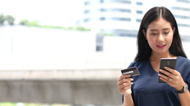 business woman shopping online on smart phone video