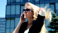 Business woman talking on cellular phone video