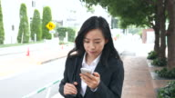 business woman talking on smart phone video