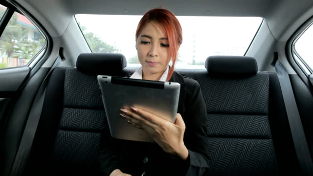 Business woman talking online video chat in car video