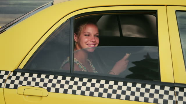 Business woman, tourist traveling by taxi, paying driver, money video