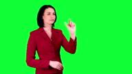 Business woman uses a virtual screen chroma key video